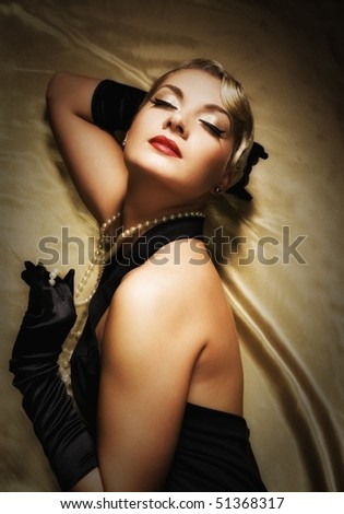 Lovely woman on golden fabric retro portrait
