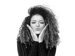 Lovely woman portrait giving a kiss with eyes closed, black and white