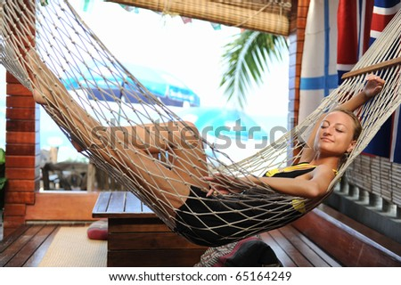 Lovely woman relaxing in a hammock