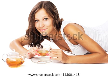 Lovely woman relaxing with a tea
