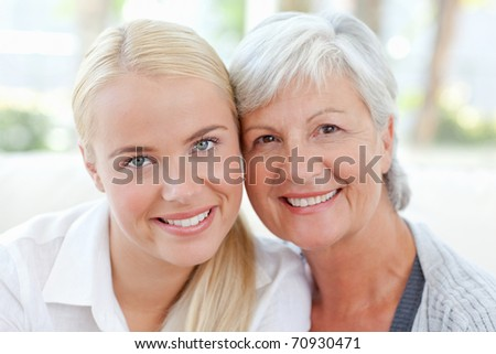 Lovely woman with her mother at home