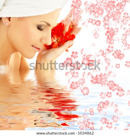lovely woman with red flower petals in water
