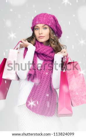 lovely woman with shopping bags over white.
