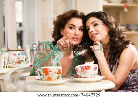 stock photo : Lovely women drinking her tea while chatting. See more images from the same shoot.