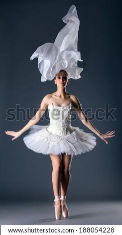 Lovely young ballet dancer posing in studio