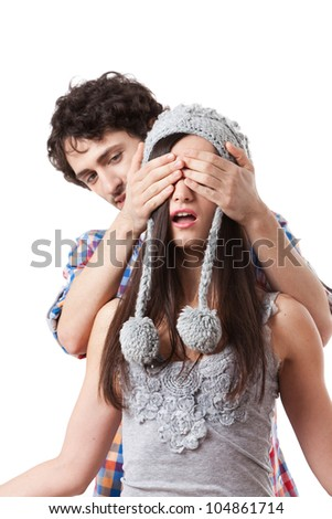 Lovely young couple having fun with a winter cap.