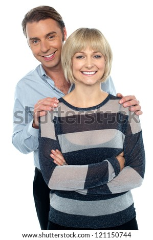 Lovely young couple portrait against white background. Love and affection. - stock photo