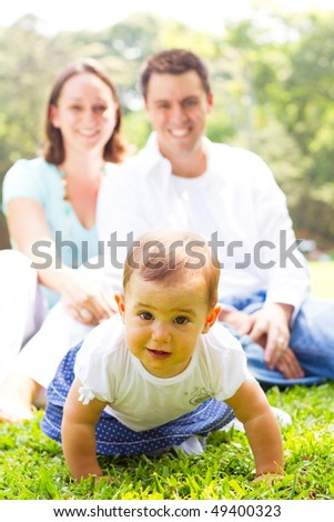 lovely young family outdoors