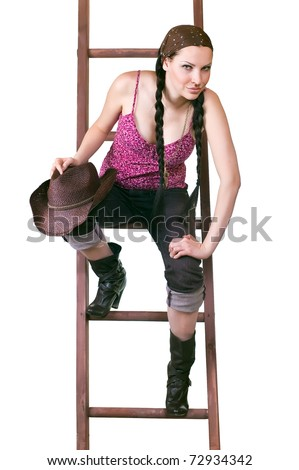 lovely young girl the cowboy with a ladder on a white background close up
