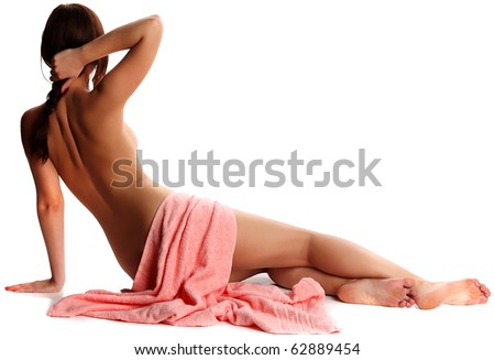 Lovely young nude woman with towel sit of back