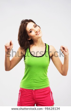 Lovely young sporty woman doing an exercise