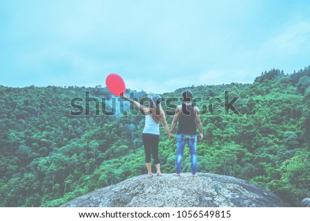 Lover women and men asian travel nature. Travel relax. Stand landscapes Natural Touch fog on the cliff rocks. Thailand Zdjęcia stock ©