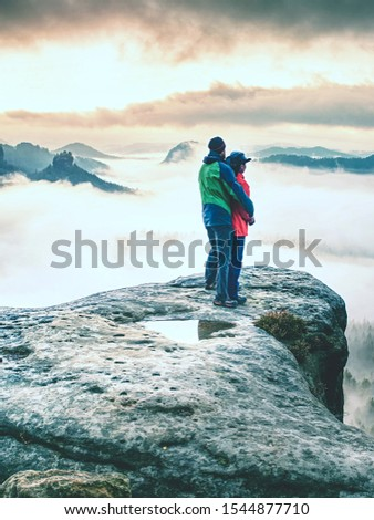 Lover women and men travel together and relax on the mountain with sunrise. Silhouette of lovers. Couple. People relationship #1544877710