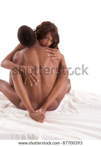 Lovers - African-American black sensual couple making love in bed