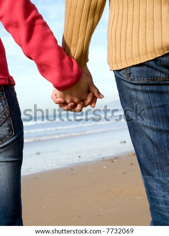 stock photo : Lovers couple holding hands on beach