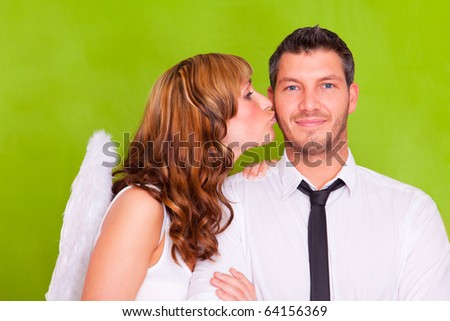 Lovers couple holding red christmas heart