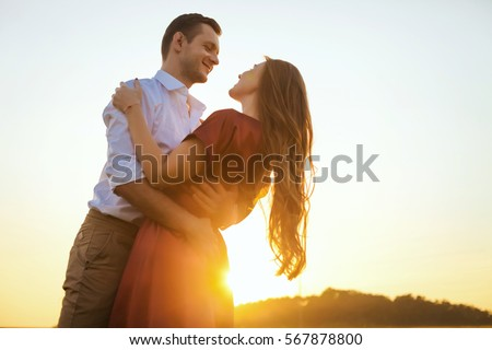 Lovers couple in love having fun dating on beach portrait. Beautiful healthy young girlfriend hugging happy boyfriend, healthy relationship concept
