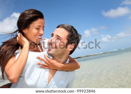 Lovers enjoying sunny day at the beach - stock photo