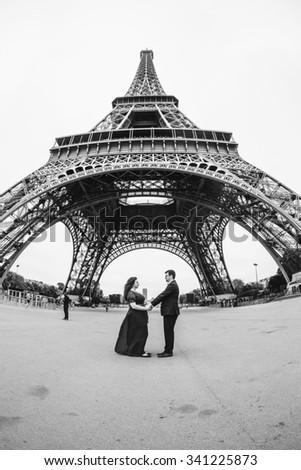 Lovers in Paris, a romantic walk through Paris in a beautiful wedding dress