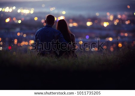 Lovers man and girl against background night city, starry sky and horizon. Concept date Valentine Day, first kiss love, forever together.