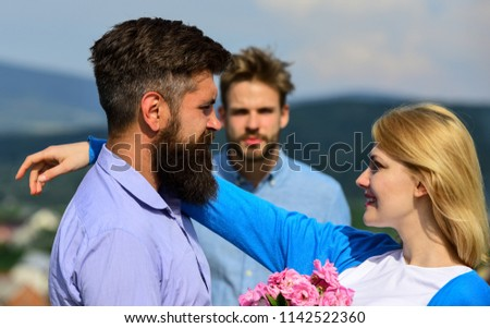 Lovers meeting outdoor flirt romance relations. Broken heart concept. Couple in love happy dating, jealous man watching woman prefers another macho instead him. Couple romantic date lovers flirting. #1142522360