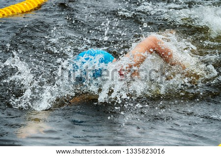 Lovers of winter swimming.Swimmer swims in the pool.He swims the distance at speed. #1335823016