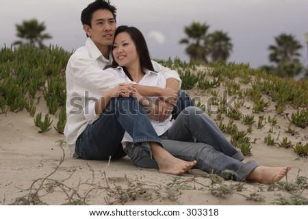 lovers on the beach - stock photo