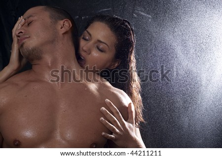 stock photo loving affectionate nude heterosexual couple in shower engaging in sexual games hugging and kissing 44211211 Click to play Roxanne Nude CLICK TO PLAY
