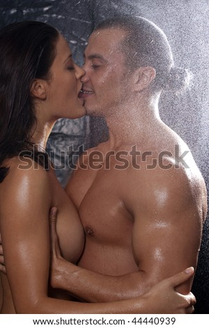 nude heterosexual couple in shower engaging in sexual.