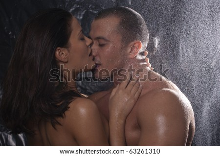 stock photo : Loving affectionate nude heterosexual couple in shower hugging