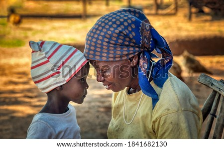 Loving African granny together with her granddaughter in a village in Botswana