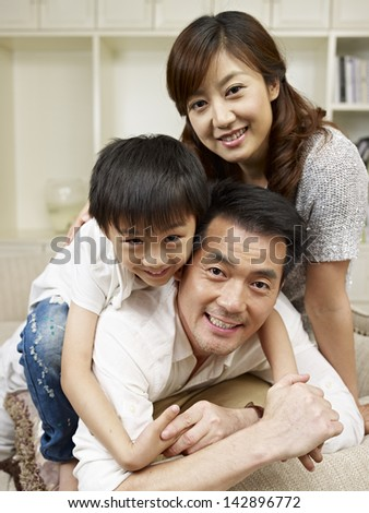 loving asian family having fun at home.
