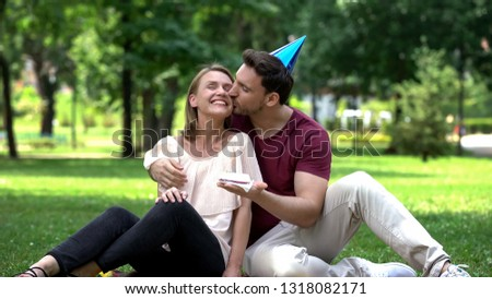 Loving boyfriend congratulating girlfriend with birthday, unexpected surprise #1318082171