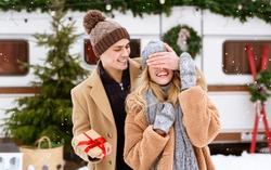 Loving Boyfriend Surprising His Girlfriend With Present During Winter Date On Snowy Day, Covering Her Eyes With Hand And Holding Gift Box, Making Pleasant Christmas, Valentine Or Anniversary Surprise
