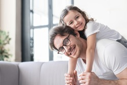 Loving cheerful young father with his small kid daughter girl having fun together, spending time, celebrating father`s day. I love you, dad! Parenthood, fatherhood concept