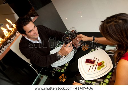 Loving couple at a romantic dinner toasting