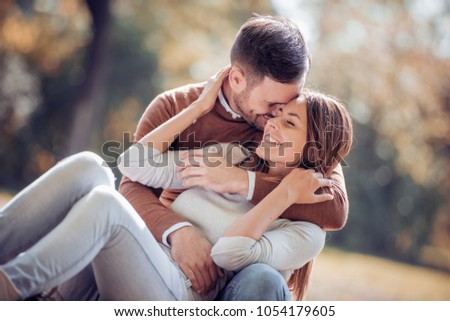 Loving couple enjoying in moments of happiness in the park. - Shutterstock ID 1054179605