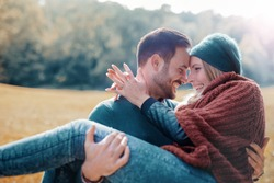 Loving couple has beautiful moments of happiness and joy in autumn park. Love and tenderness.Lifestyle concept
