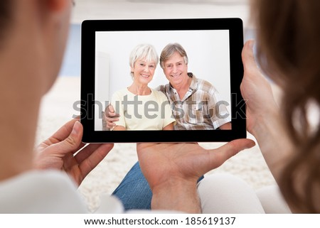 Loving couple having online video conference at home