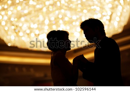 Loving couple holding hand
