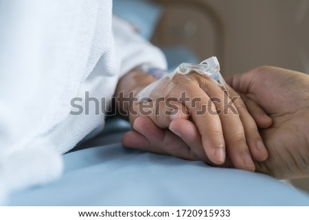 Loving couple holding hands, Hopeful, care love emotional concept, Together women hold hand lover while Sick Patients with Infusion pump infuses fluid. Encouragement comforting Recovering from family Foto d'archivio ©