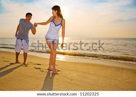 couple holding hands in sunset. couple holding hands