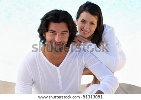 Loving couple in white on a bright sunny day