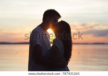 loving couple kissing at sunset. love in the sun. Valentine's day in nature beach #787431265