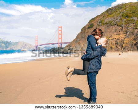 Loving couple man and woman hugging on beach in San Francisco on Golden gate bridge background on Sunny day #1355689340