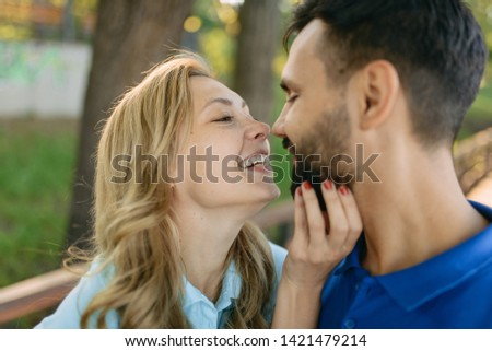 Loving couple on a date in the park #1421479214