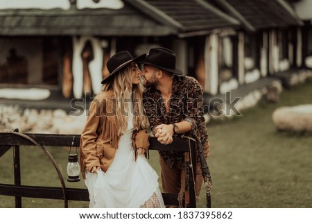 Photo of  Loving couple on a  ranch in the western mountains in the autumn season. Elopement concept
