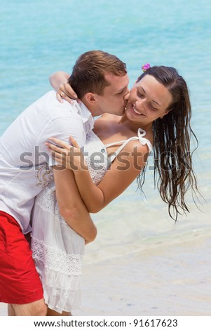 loving couple on beach - stock photo