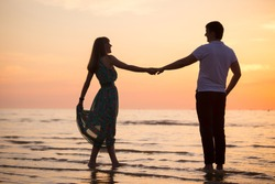 loving couple on the coast,dancing. people's attitudes. love story.