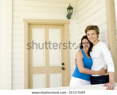 Loving couple outside of their home